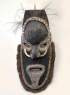 Papua New Guinea Mask with Shell Decoration. Click for more information...