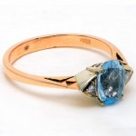 9ct Yellow Gold Aquamarine and 4 Diamond Ring. Click for more information...