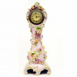 A German Clock Coburg Porcelain Movement by Junghans. Click for more information...